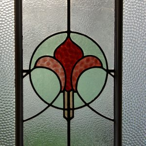 Light coming through a stained glass window pane